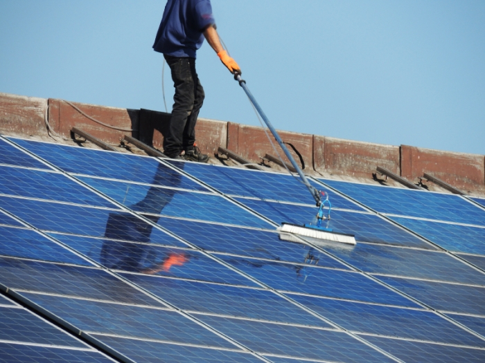 How to Maintain Solar Panels:Dip the brush into the soap and water mixture and gently rub it over the solar panels